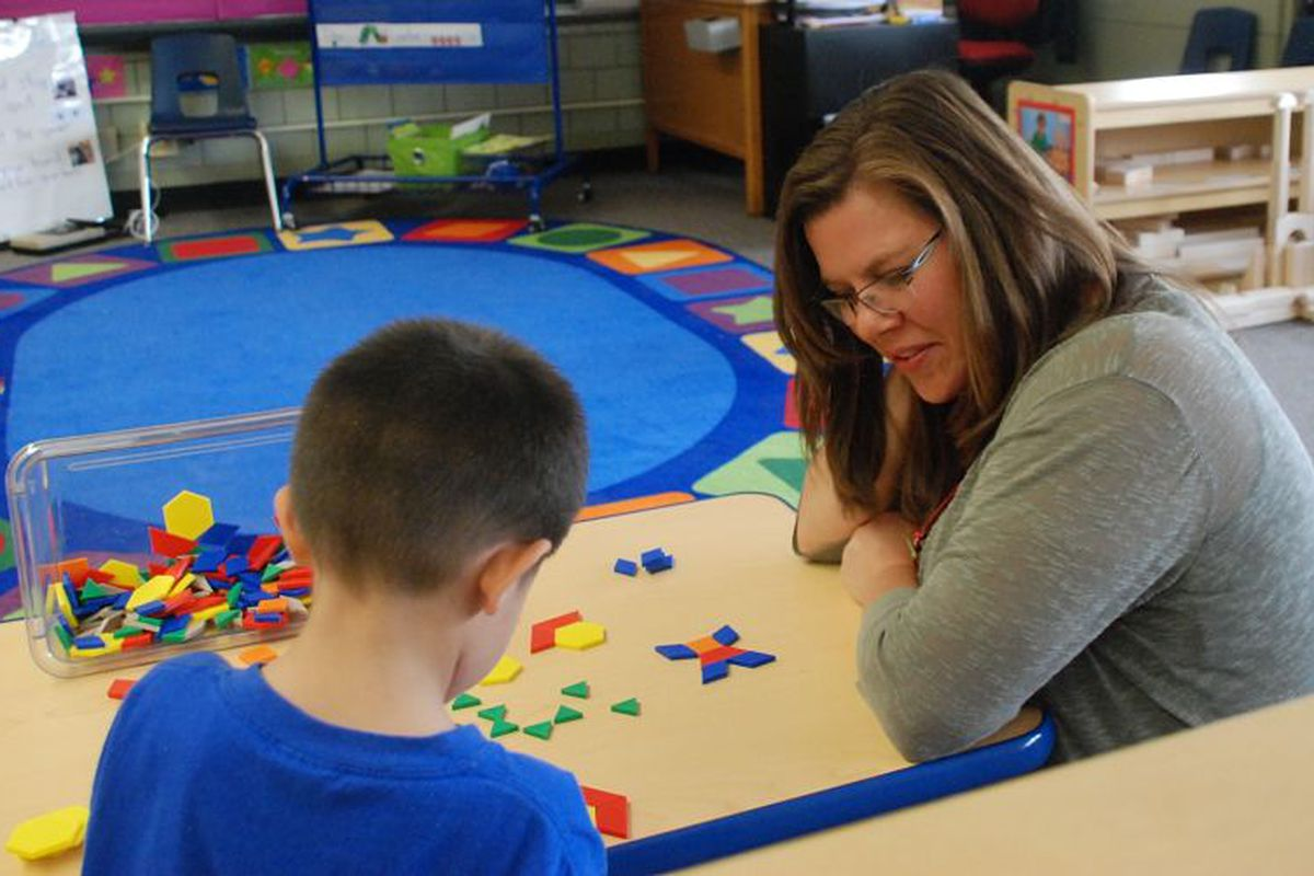 Brandy Barhite works with a preschool student at Beach Court Elementary.