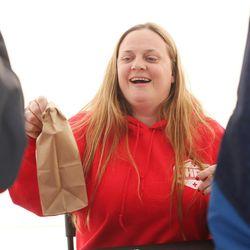 Social worker Mindy Vincent hands out syringes during an exchange program in Salt Lake City on Thursday, Dec. 29, 2016. Vincent is a former drug addict who is now clean. After she lost a sister to an overdose, she decided to start Utah's first syringe exchange program.