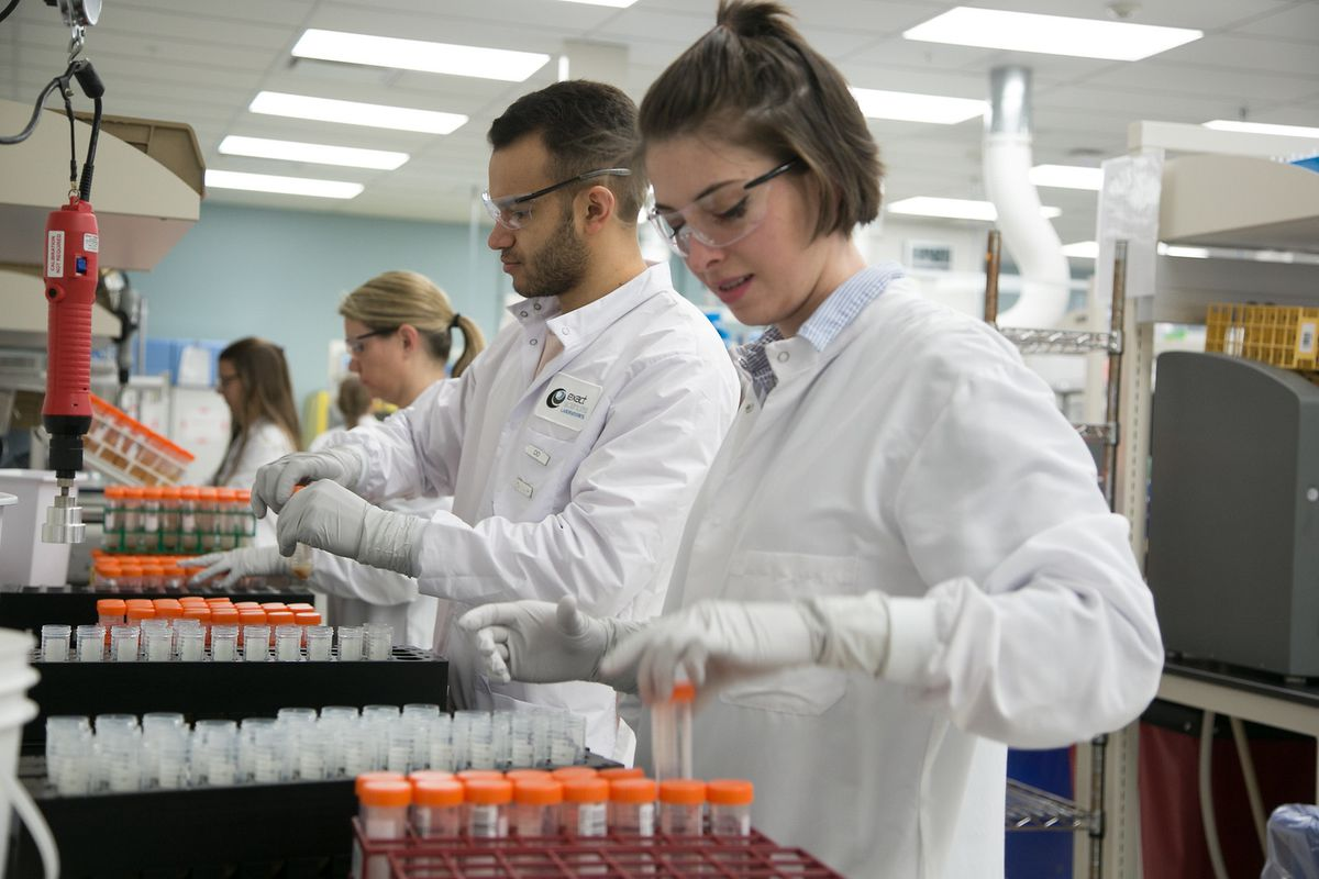 A technician labels tubes at Exact Sciences Laboratories. With two dozen steps to the testing procedure over a period of days, making sure patient information stays with every sample is a priority.