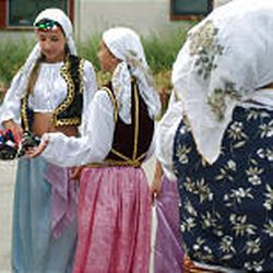 Dancers from the folk group Kolo get ready to bring some Bosnian culture to the audience at a recent performance at Liberty Park.
