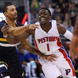 Utah Jazz guard George Hill (3) fouls Detroit Pistons guard Reggie Jackson (1) as the Utah Jazz and the Detroit Pistons play at Vivint Smart Home arena in Salt Lake City. The Jazz won, 110-77, on Friday, Jan., 13, 2017.