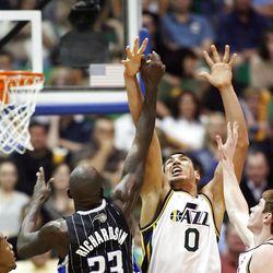 Utah Jazz forward Enes Kanter (0) battles Orlando's #23 Jason Richardson for the ball as the Utah Jazz and the Orlando Magic play Saturday, April 21, 2012 in Energy Solutions arena.