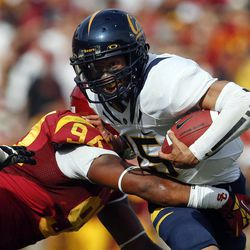 California quarterback Zach Maynard, right, is sacked by Southern California defensive end Leonard Williams during the first half of an NCAA college football game in Los Angeles, Saturday, Sept. 22, 2012.