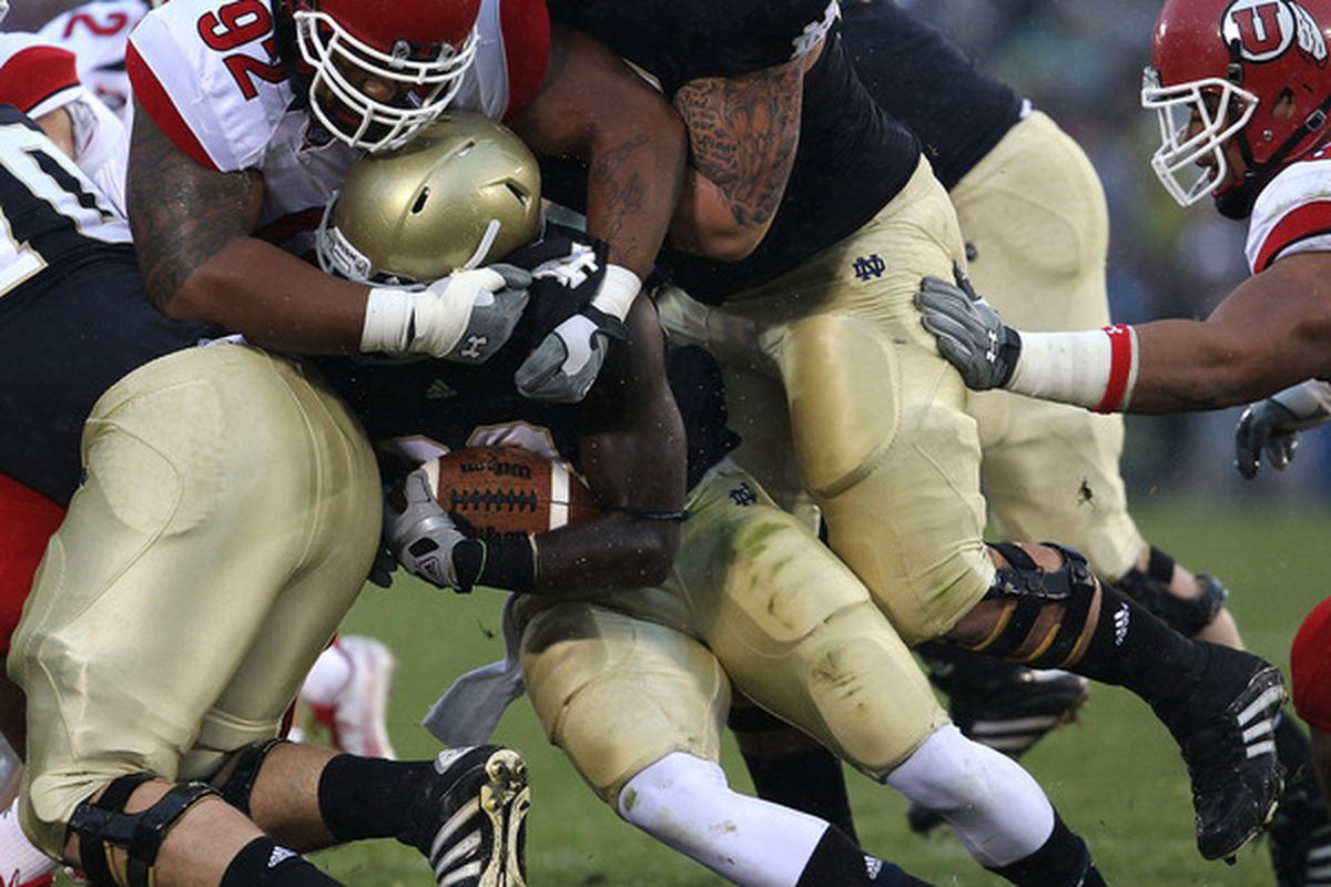 Rumor has it that Star Lotulelei (No. 92) ate this Notre Dame running back after the whistle.