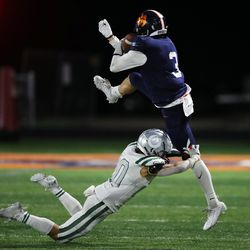 Olympus' Josh Peterson takes down Brighton's Dante McMaster as they play a high school football game at Brighton in Cottonwood Heights on Friday, Sept. 10, 2021. Olympus won 35-28.