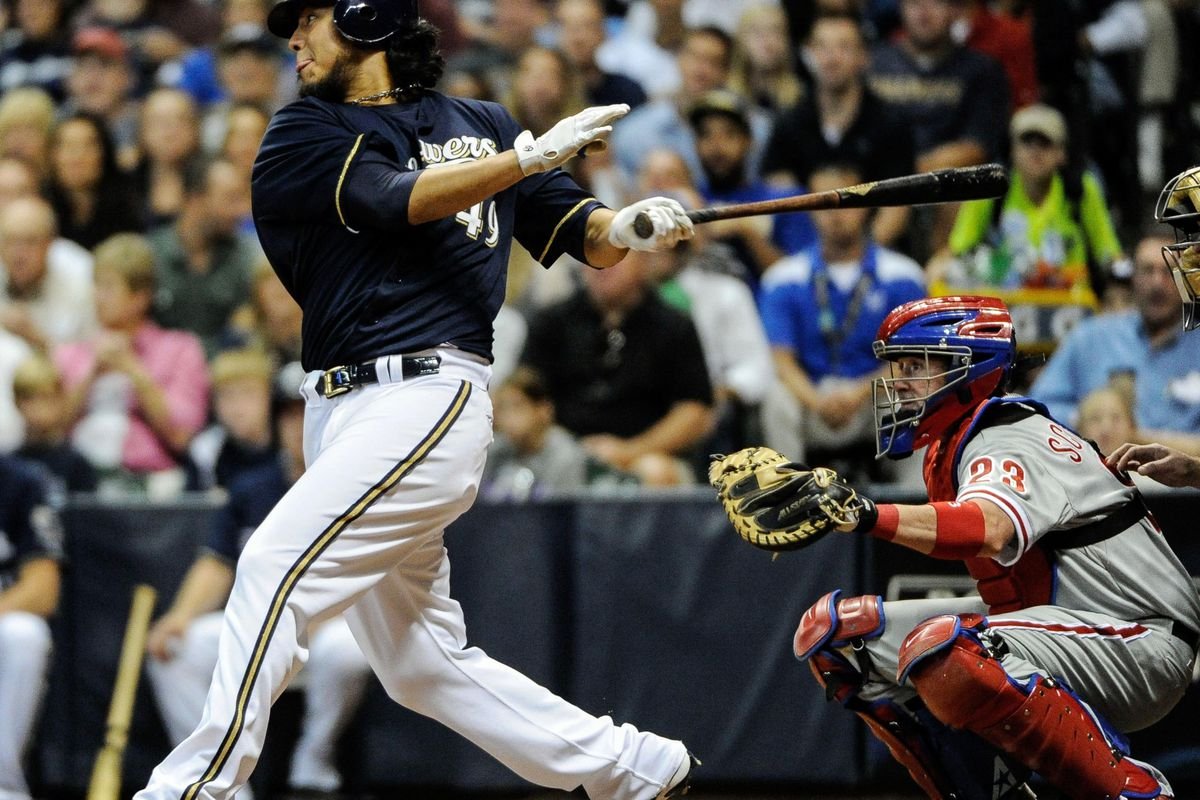 Aug 17, 2012; Milwaukee, WI, USA; Milwaukee Brewers pitcher Yovani Gallardo (49) hits a single to drive in two runs against the Philadelphia Phillies in the fourth inning at Miller Park.  Mandatory Credit: Benny Sieu-US PRESSWIRE