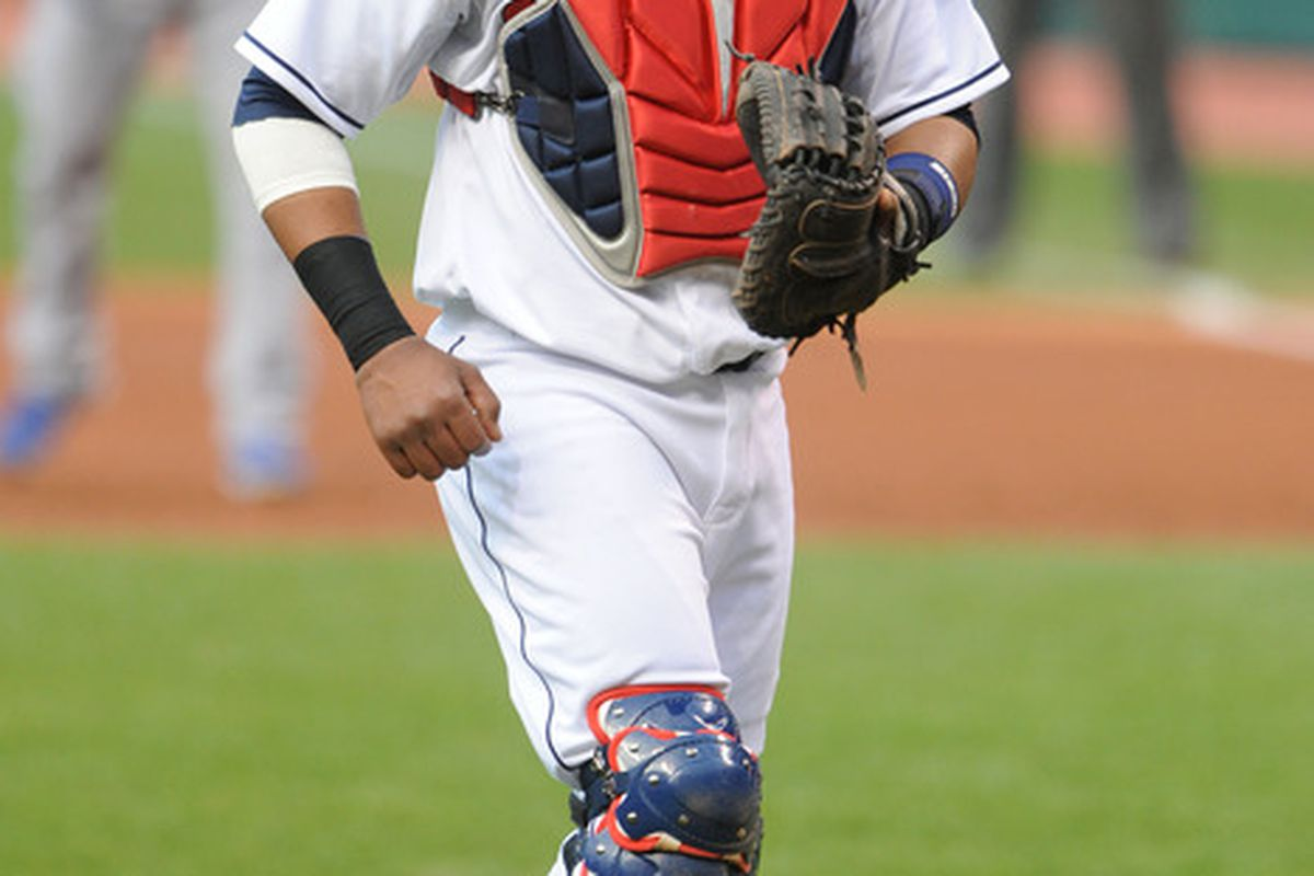 April 25, 2012; Cleveland, OH, USA: Cleveland Indians catcher Carlos Santana (41) walks back to home plate during the first inning against the Kansas City Royals at Progressive Field.  Mandatory Credit: Eric P. Mull-USPRESSWIRE