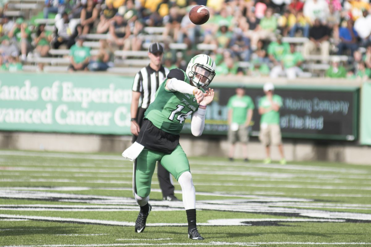 Chase Litton (14) fires a pass in his first start for the Herd.