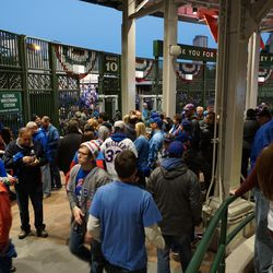 Lines at the alcohol wristband tables, creating congestion just inside the bleacher gate