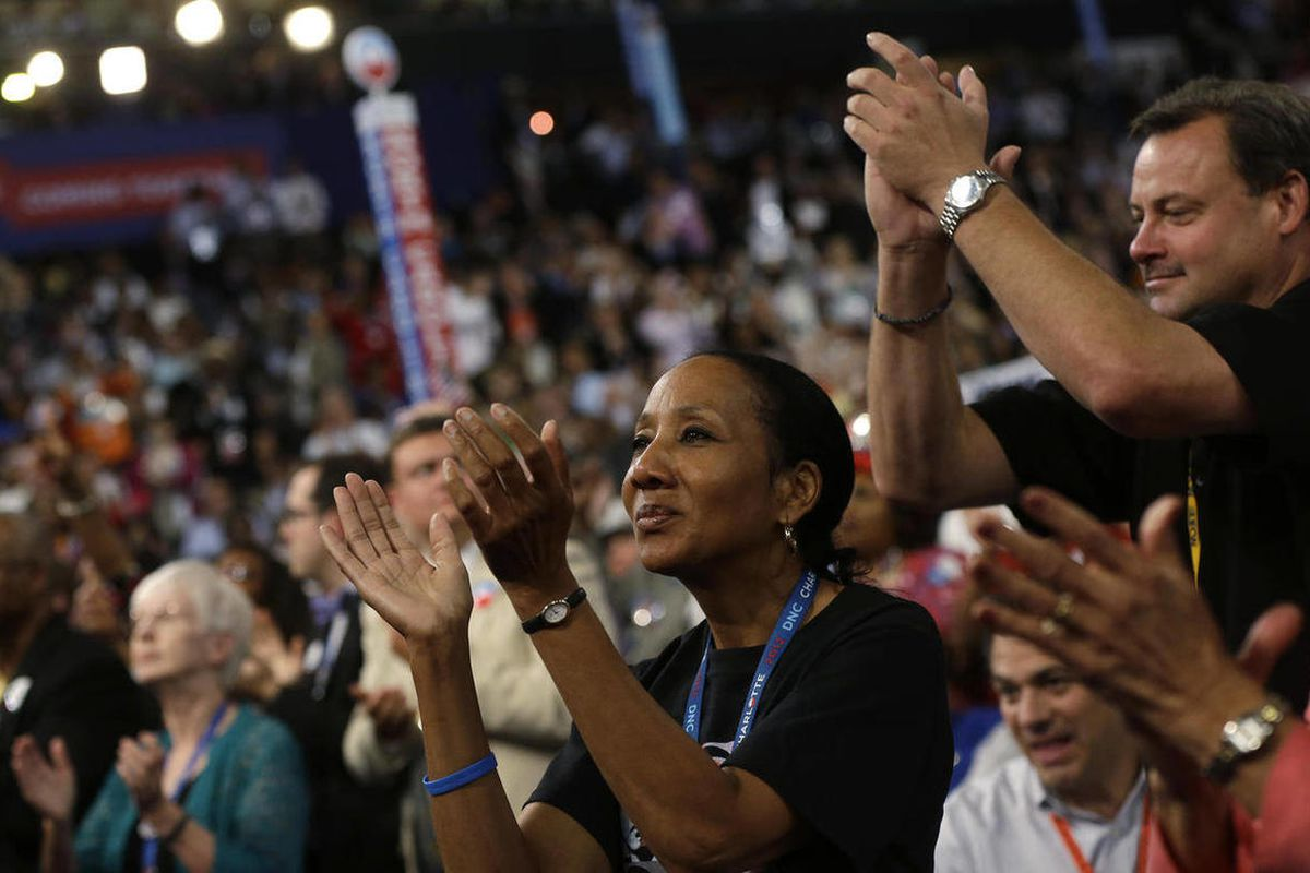 Delegates reacts as Rep. John Lewis of Georgia speaks during the Democratic National Convention in Charlotte, N.C., on Thursday, Sept. 6, 2012.