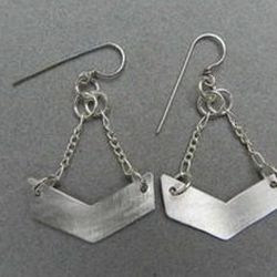 "<a href=""http://www.threadflip.com/items/2979""> Geometric aluminum chevron earrings, $26.00</a>"