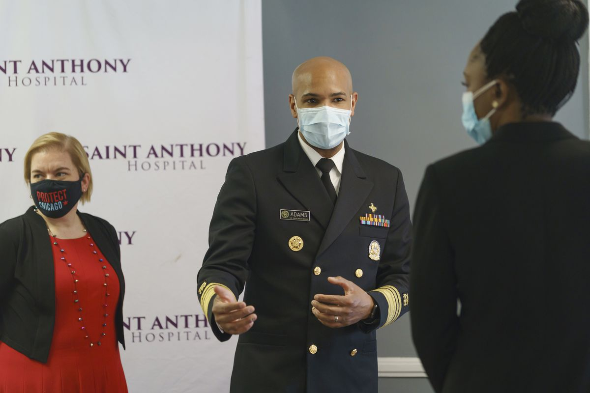 U.S. Surgeon General Jerome Adams, center, is joined by Chicago Health Commissioner Dr. Allison Arwady, left, and Illinois Public Health Director Dr. Ngozi Ezike during their visit at Saint Anthony Hospital in Chicago, Tuesday, Dec. 22, 2020.