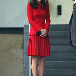 Wearing a red custom Alexander McQueen dress and black Stuart Weitzman pumps to Anna Freud Centre Family School's Christmas Party in London on December 15th, 2015.
