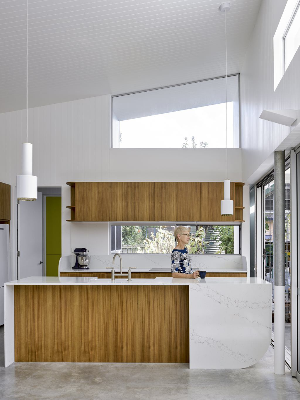 Kitchen with white walls and pendant lamps