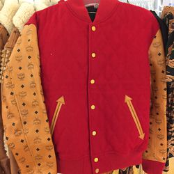 Red MCM jacket, $1,818 (was $3,030)