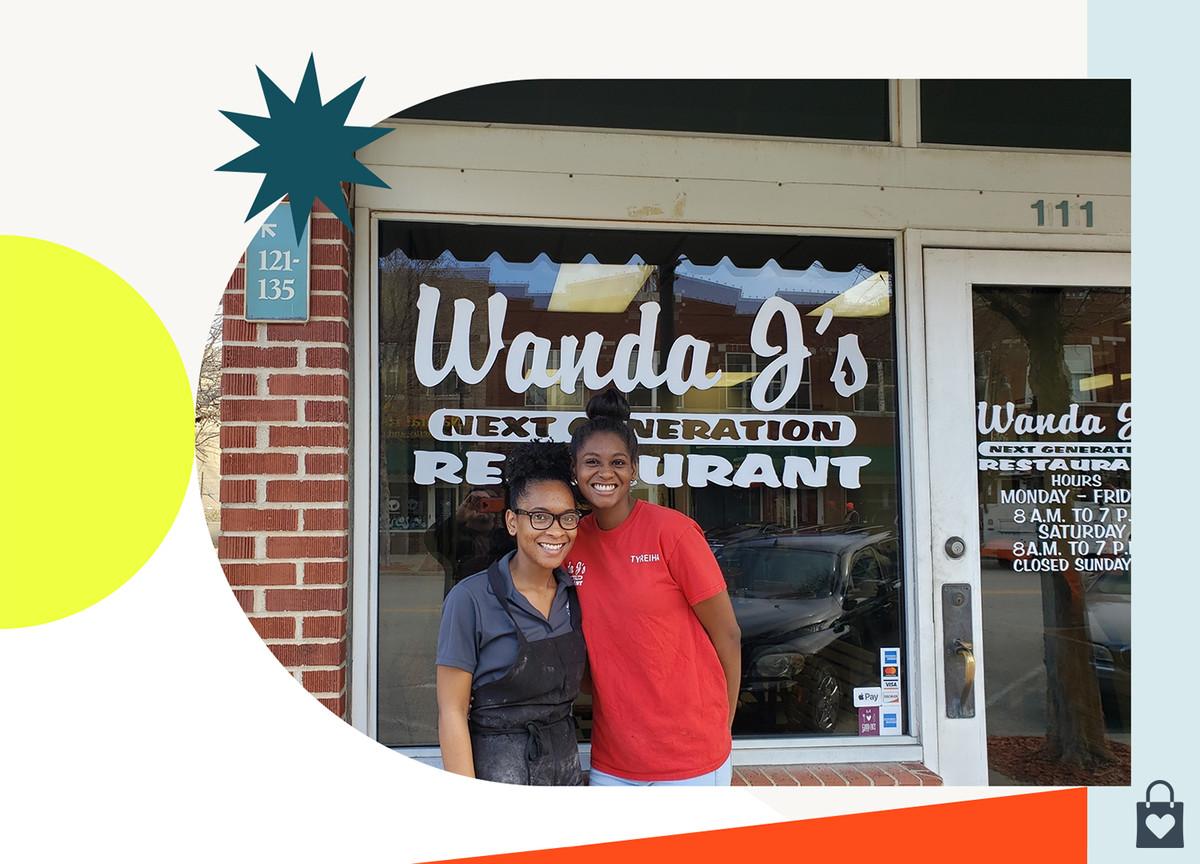 Two people posing outside of Wanda J's restaurant in Tulsa