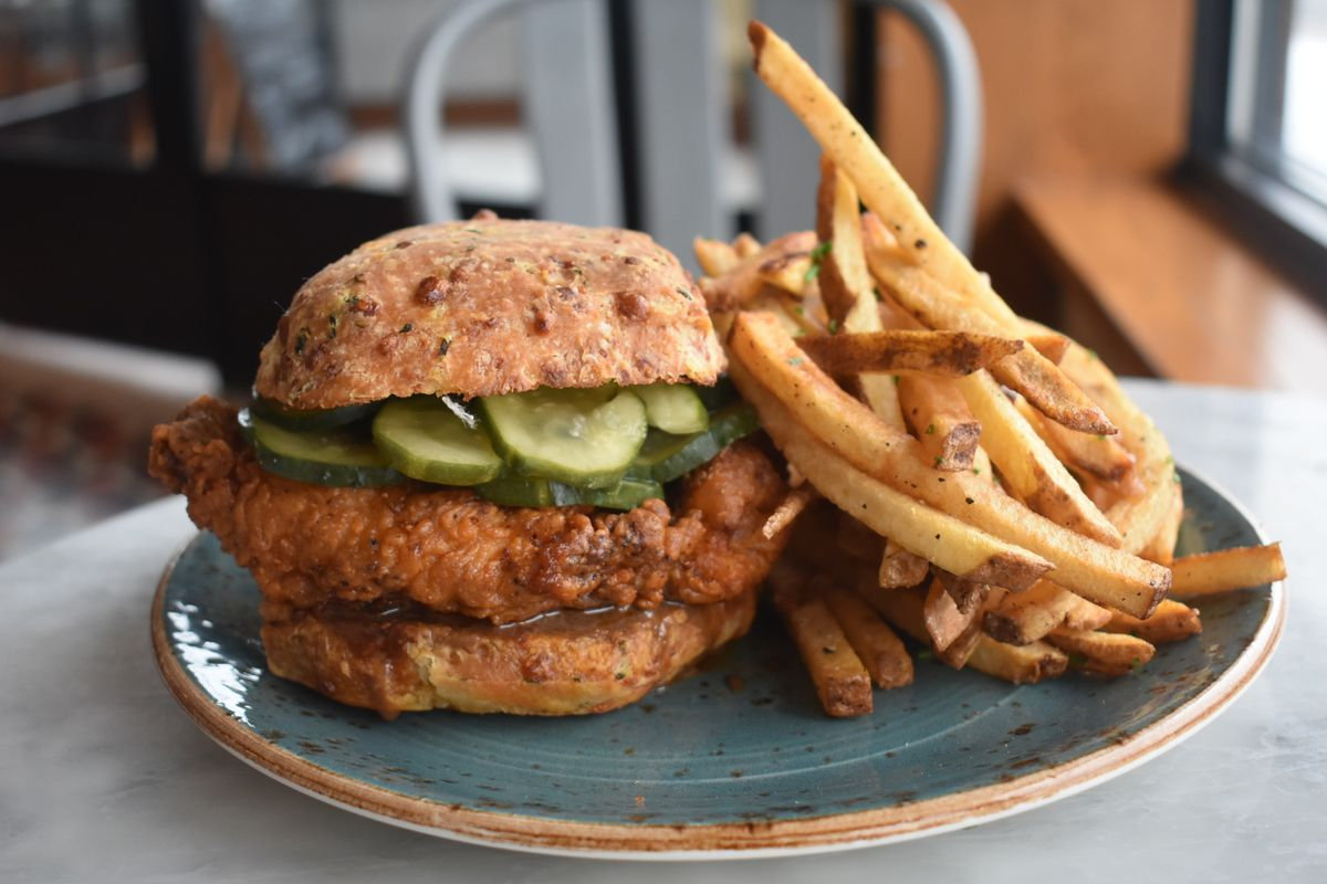 """2c296f210b7bef A """"Louisville"""" hot chicken sandwich made with aged honey and a smoked  gochujang sauce. Amanda Hoey WildHeart Media"""