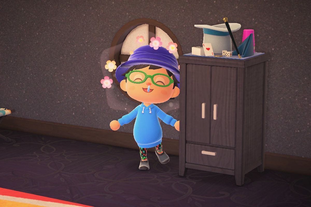 A happy villager stands next to a black dresser in Animal Crossing: New Horizons