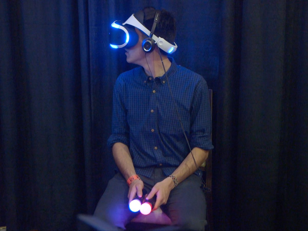 An attendee of the Virtual Reality L.A. Spring Expo tries Sony's Project Morpheus.