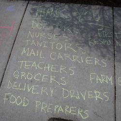 Thank you messages for doctors, nurses, teachers, grocers and more written in sidewalk chalk outside a home on South Loomis Street near West Harrison Street in the Little Italy neighborhood during the coronavirus pandemic, Monday afternoon, April 6, 2020.