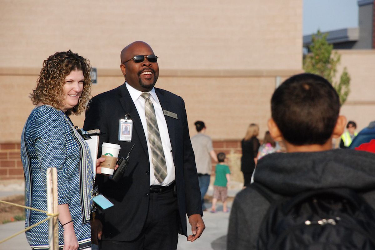 Aurora Public Schools Superintendent Rico Munn, center, greets students at the Mosley P8 school on opening day with Principal Carrie Clark.
