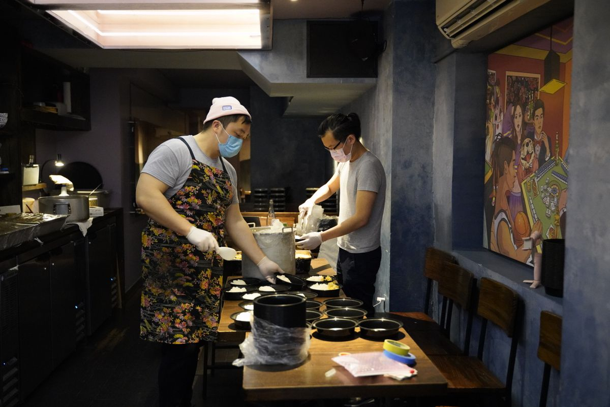 The chef Eric Sze seen here preparing meal boxes