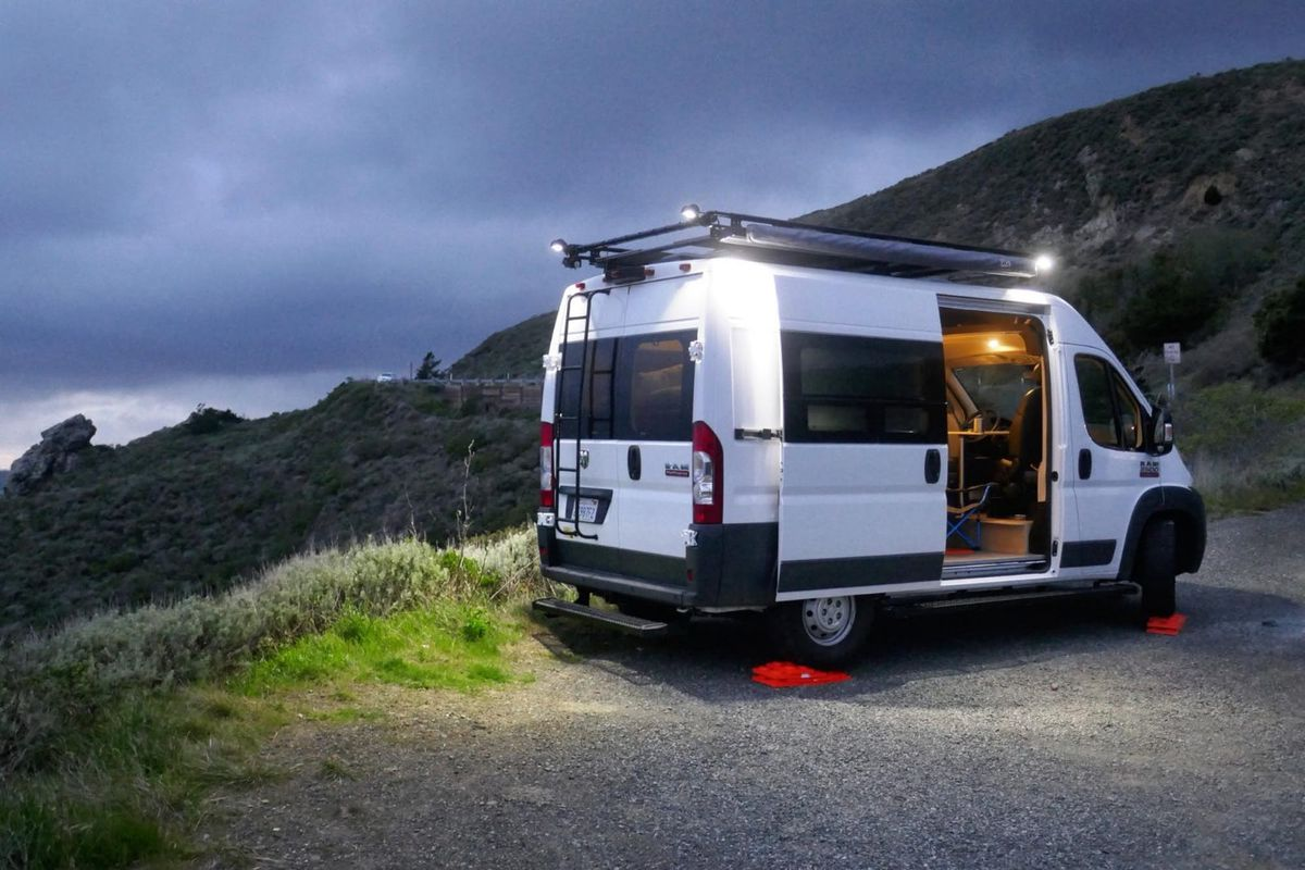 Affordable camper van comes with a rooftop deck curbed for Rv with roof deck
