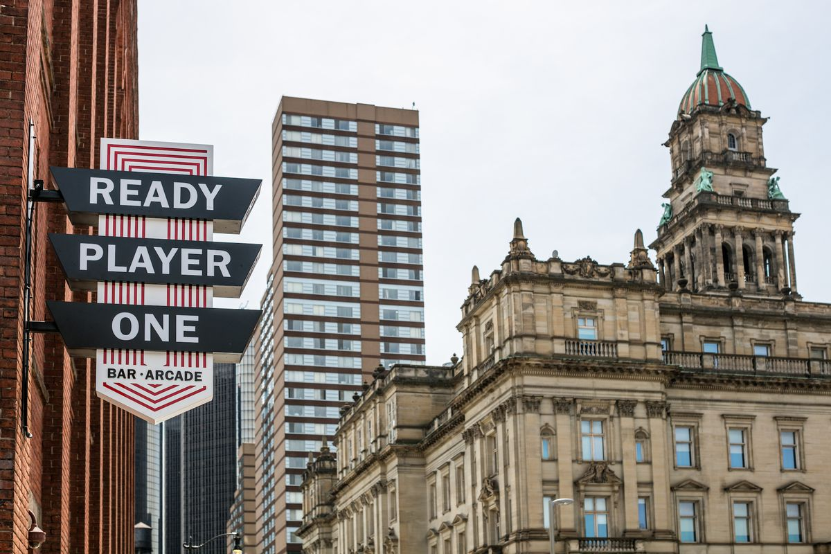 signage with detroit skyline in background
