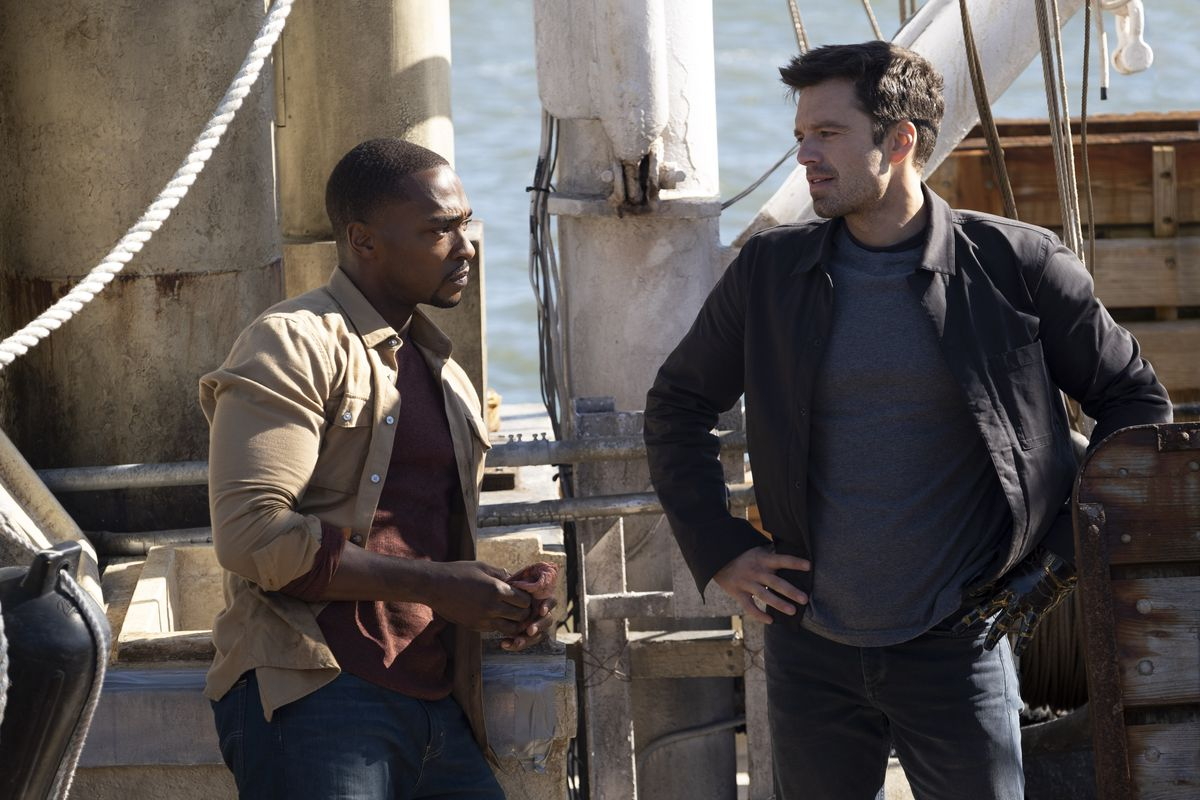 Anthony Mackie and Sebastian Stan stand on a boat's deck in The Falcon and the Winter Soldier