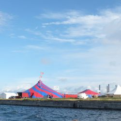 The festival site and symposium big top.