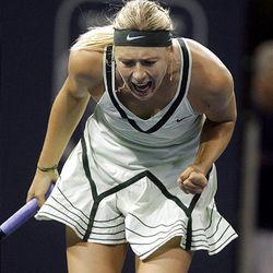 Maria Sharapova, of Russia, reacts after a point against Urszula Radwanska, of Poland, during a quarterfinal match.