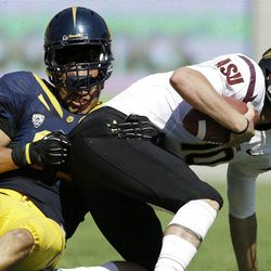 Arizona State quarterback Taylor Kelly, right, is sacked by California's Brennan Scarlett during the first half of an NCAA college football game in Berkeley, Calif., Saturday, Sept.  29, 2012. (AP Photo/Marcio Jose Sanchez)