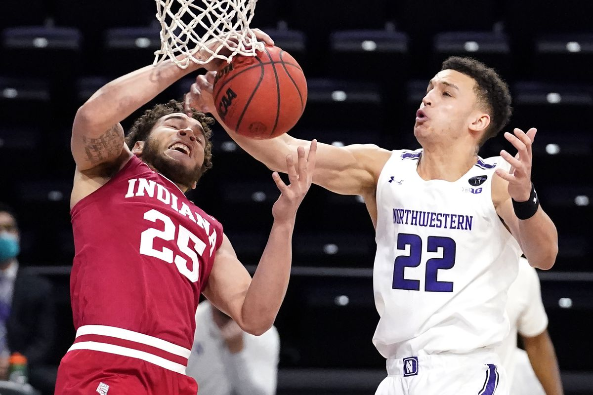 Indiana forward Race Thompson, left, and Northwestern forward Pete Nance battle for a rebound during the first half of Wednesday's game in Evanston.