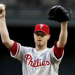 Philadelphia Phillies' Kyle Kendrick asks for a new baseball during the first inning against the Arizona Diamondbacks, in which he gave up four runs, during a baseball game Monday, April 23, 2012, in Phoenix.