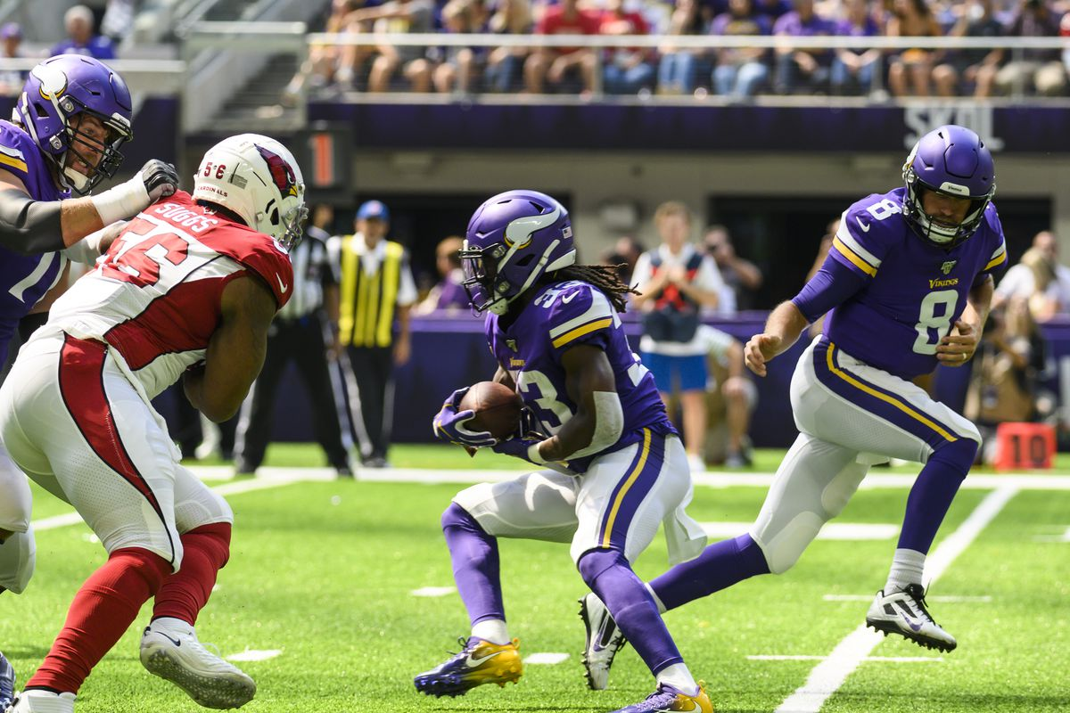 Minnesota Vikings quarterback Kirk Cousins hands off the ball to Dalvin Cook in the first quarter of the preseason game against the Arizona Cardinals at U.S. Bank Stadium on August 24, 2019 in Minneapolis, Minnesota.