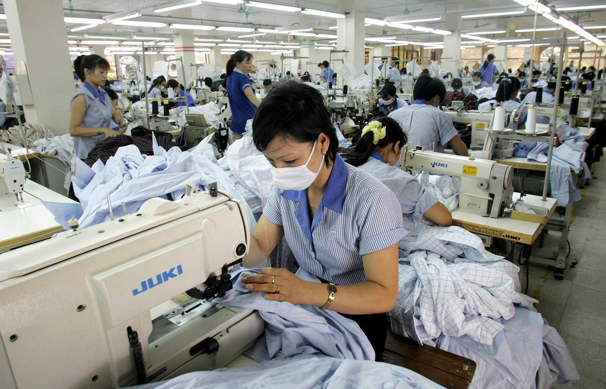 Vietnam garment workers at sewing machines
