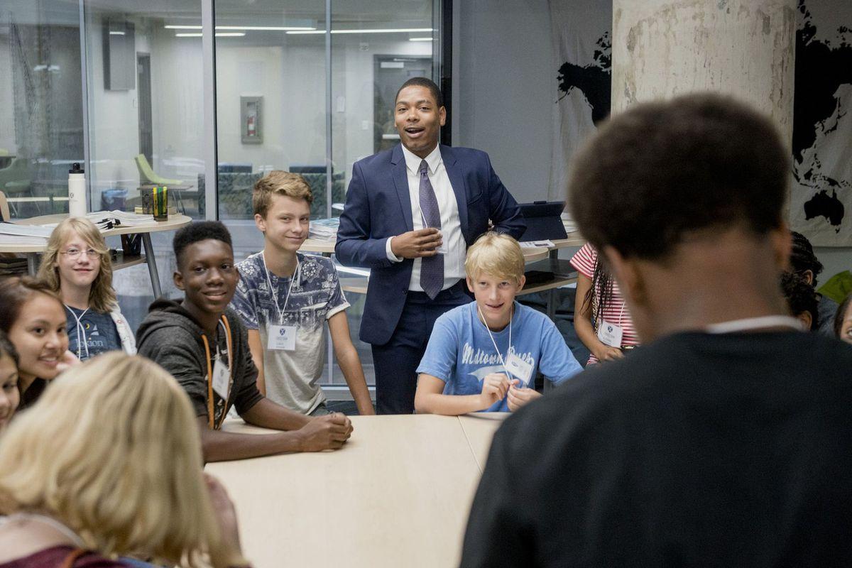 English teacher Deion Jordan speaks with Crosstown High School's inaugural ninth grade class on the first day of school.