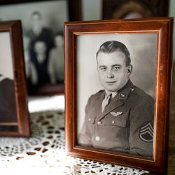 A portrait of Max Wendell Lower, taken while he served in the Army Air Forces during World War II, is displayed in the home of his sister, Helen Lower Simmons, in Logan on Thursday, Nov. 14, 2019. Max Lower was killed when his plane was shot down during the Operation Tidal Wave attacks on Romanian oil refineries during the war. His remains were recently identified using DNA technology and will soon be returned to his family in Utah.