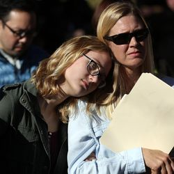 Sophie Milne and Alyssa Milne listen to speakers during the LDS Church Mass Resignation at City Creek Park in Salt Lake City on Saturday, Nov. 14, 2015.