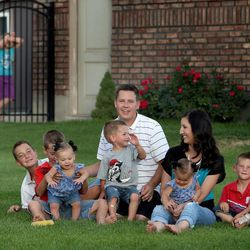 The Hyde family of Syracuse on Thursday, Aug. 1, 2013. Dax, Davis, Hattie, Will, dad Trent, mom Camilla, Hazel, Gabe and Laryn.