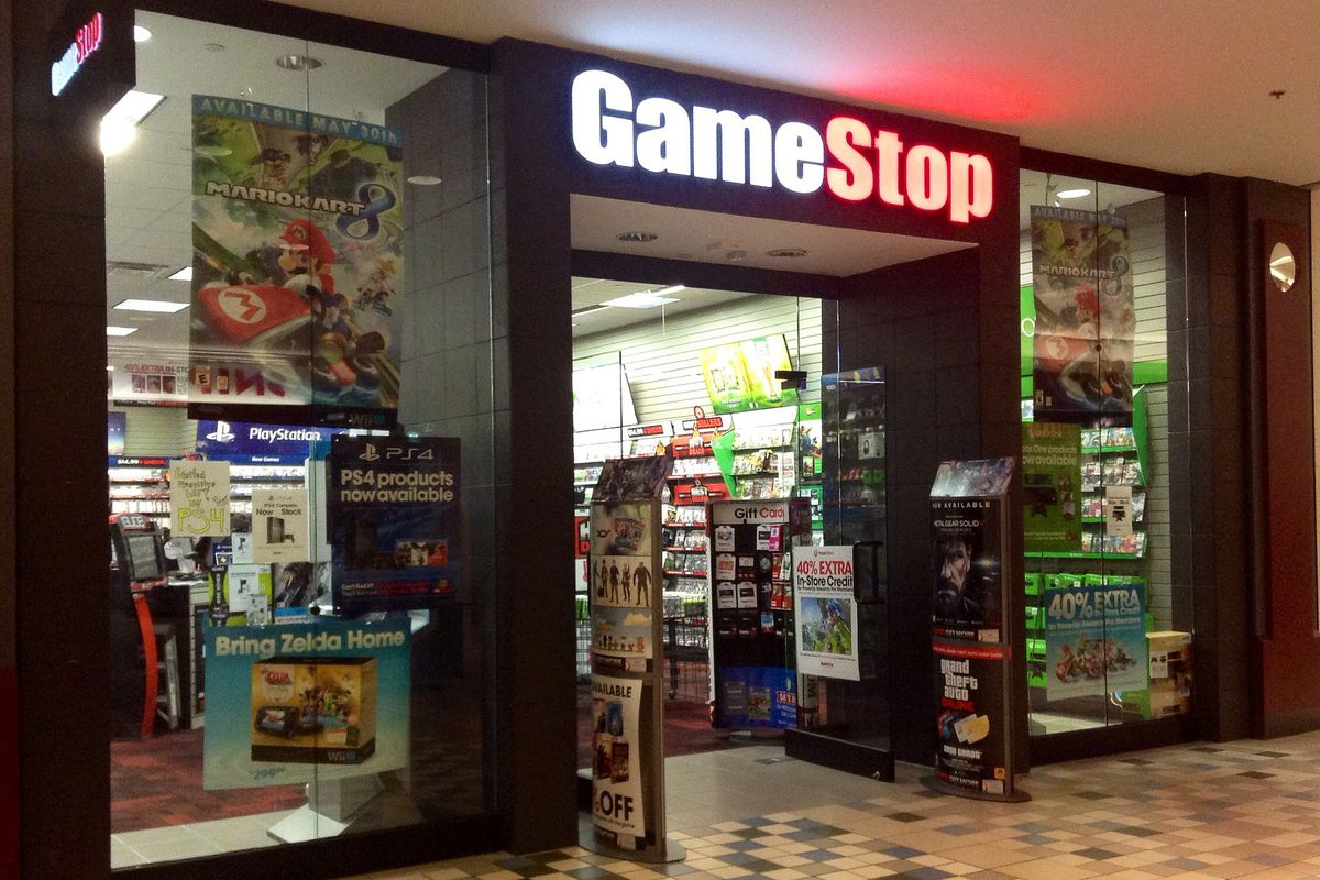 A GameStop storefront inside a shopping mall.