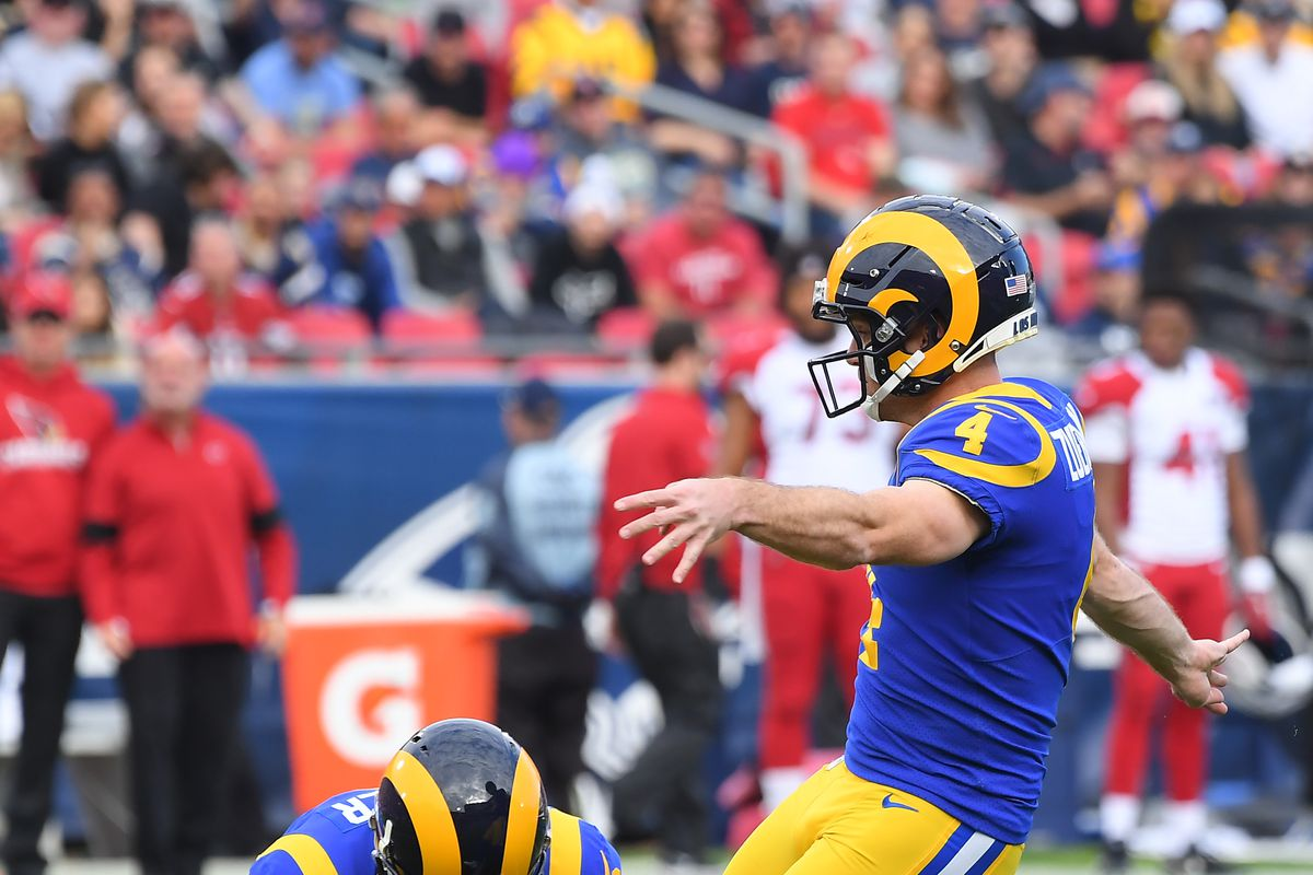 Long snapper Jake McQuaide sets the ball as kicker Greg Zuerlein of the Los Angeles Rams kicks a field goal in the game against the Arizona Cardinals at the Los Angeles Memorial Coliseum on December 29, 2019 in Los Angeles, California.