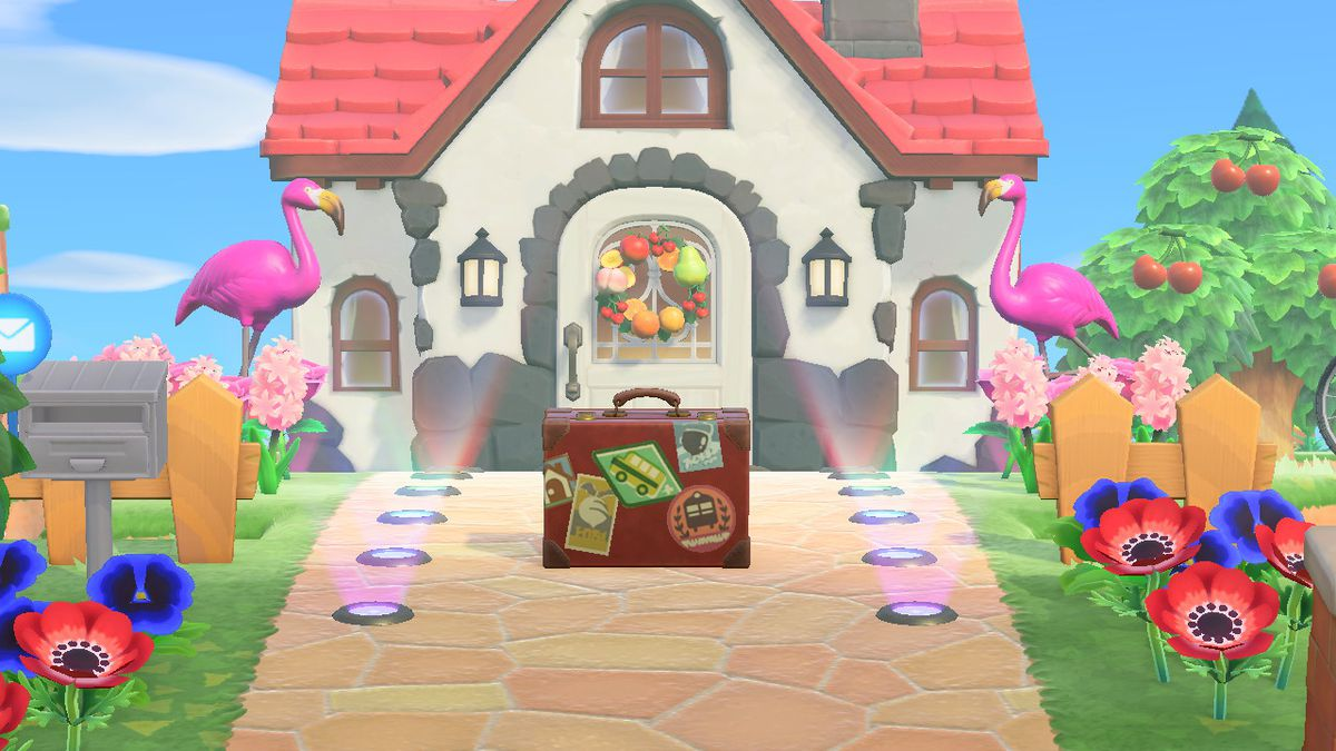 Rover's Briefcase sits on a path in front of a house