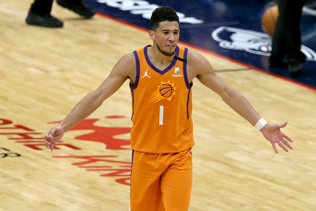 Devin Booker of the Phoenix Suns reacts to a call during the first half of a NBA game against the New Orleans Pelicans at Smoothie King Center on February 19, 2021 in New Orleans, Louisiana.
