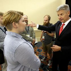 Libertarian presidential candidate Gary Johnson, right, speaks to supporters and delegates at the National Libertarian Party Convention on Friday, May 27, 2016, in Orlando, Fla.