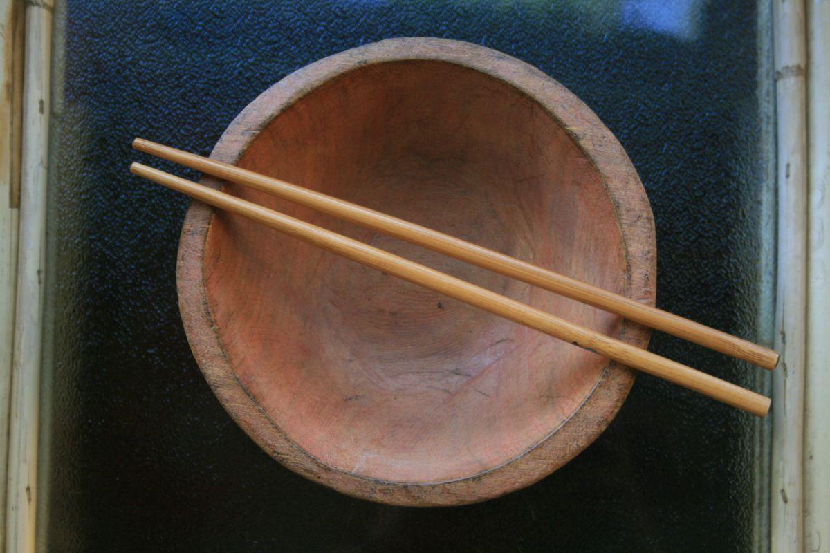 Chopsticks on a bowl