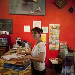 In this Aug. 31, 2012 photo, Kelly Thomas, owner of the coffee shop and bookstore El Gato Negro, which was frequently visited by U.S. citizen Jason Sachary Puracal, works in her cafe iin San Juan del Sur, Nicaragua. As a three-judge appellate panel mulls the 35-year-old American's fate, the case has drawn the scrutiny of U.S. lawmakers and human-rights advocates, including the California Innocence Project, which works to absolve people who have been wrongfully convicted. In late 2010 masked policemen raided his seafront real estate office and took him to Nicaragua's maximum security prison. Prosecutors charged that Puracal was using his business as a front for money laundering in a region used to transport cocaine from Colombia to the United States. Because no drugs or cash were seized, Puracal's family and friends thought he wouldn't be held long, but nine months later, a judge convicted Puracal and sentenced him to 22 years in prison.