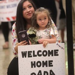 Amanda Duke and her daughter Leslee Duke wait for 1st Lt. Taylor Duke to arriveat the Salt Lake International Airport in Salt Lake City on Tuesday, Aug. 27, 2019, as 1st Lt. Duke and other members of the Utah National Guard's 4th Infantry Division Main Command Post Operational Detachment return home after serving in Afghanistan for 10 months in support of Operation Freedom's Sentinel.