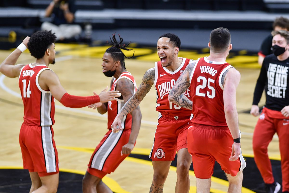 Ohio State Buckeyes guard CJ Walker reacts with forward Kyle Young after the game against the Iowa Hawkeyes at Carver-Hawkeye Arena.