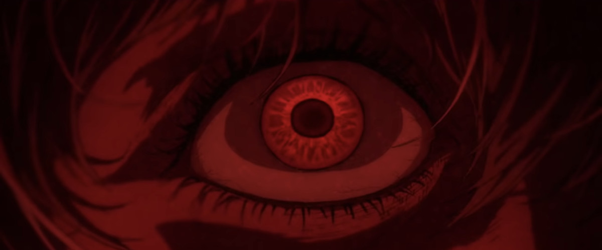 A wide, red eyeball in closeup in Evangelion 1.0+3.0: Thrice Upon a Time